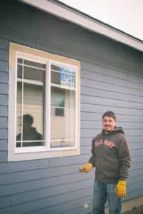 Seth Anderson, Principal Architect, painting at the Habitat for Humanity community service day