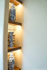Shelving with decorative vases in residential remodel