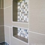 Shower tile inset in a residential bathroom remodel