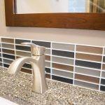 Colored tile backspash in residential bathroom