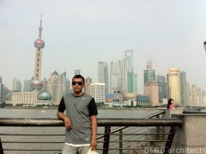 On Marco's visit to China, he spent time in Shanghai. Here he is pictured with the city's skyline in the background.